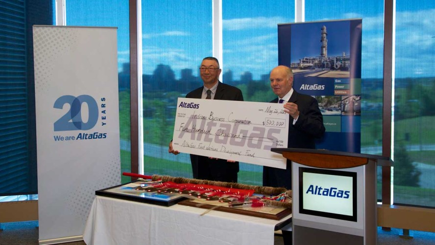 General manager for the Indian Business Corporation Rob Rollingson (left) and AltaGas CEO David Cornhill hold up %500,000 cheque.