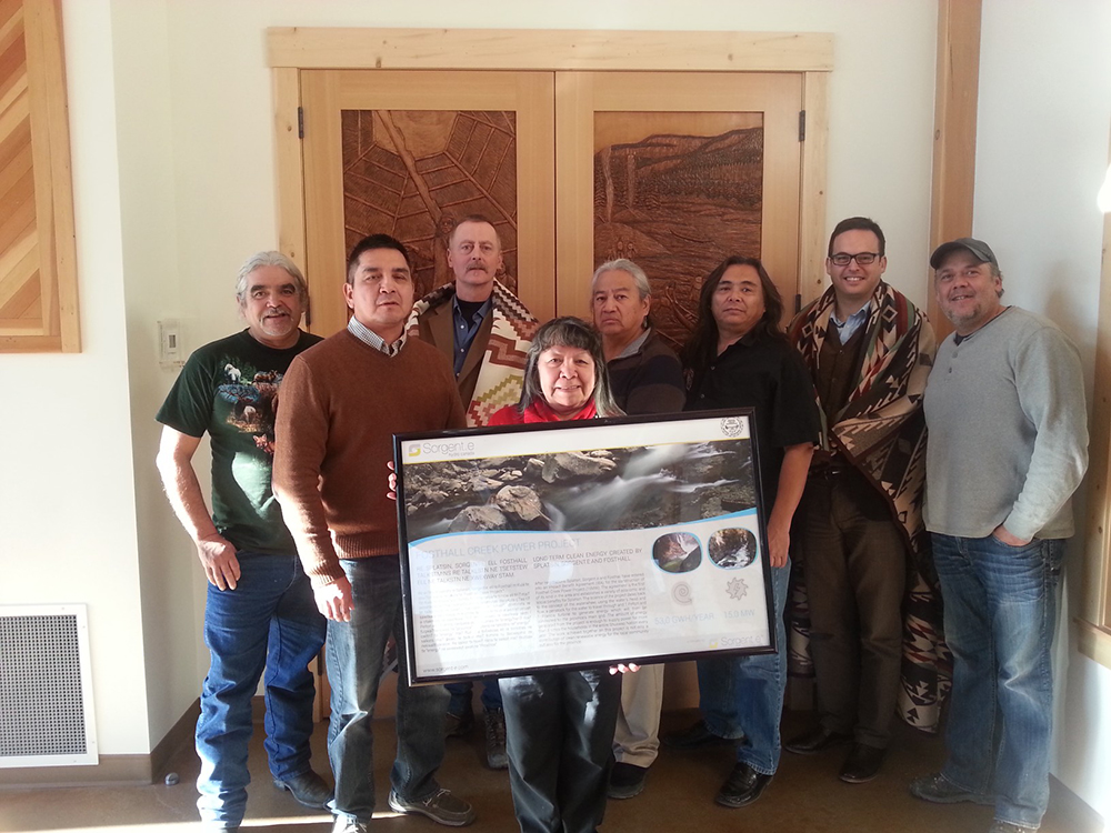 From left to right: Councillor Lawrence Williams, Councillor Daniel Joe, Darcy Fear from Fosthall Creek Power Ltd., Councillor Jean M. Brown,  Chief Wayne Christian, Councillor George William, Lucas de Haro from Sorgent.e Hydro Canada, and Councillor Reno Lee during the gifts exchange after signing the agreement.