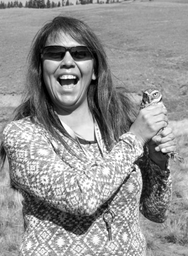 Bernadette Manual holds a Burrowing Owl before its release back into the wild.