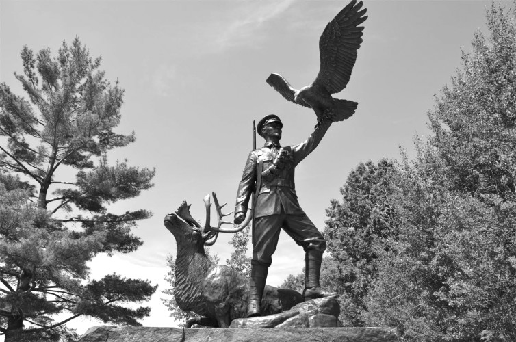 The life-sized bronze monument, created by Sudbury-based sculptor Tyler Fauvelle is situated on the Georgian Bay waterfront at the Charles W. Stockey Centre for the Performing Arts, Parry Sound, Ontario.