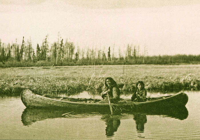 A Chipewyan woman and child set out to hunt muskrat in Garson Lake, western Saskatchewan.
