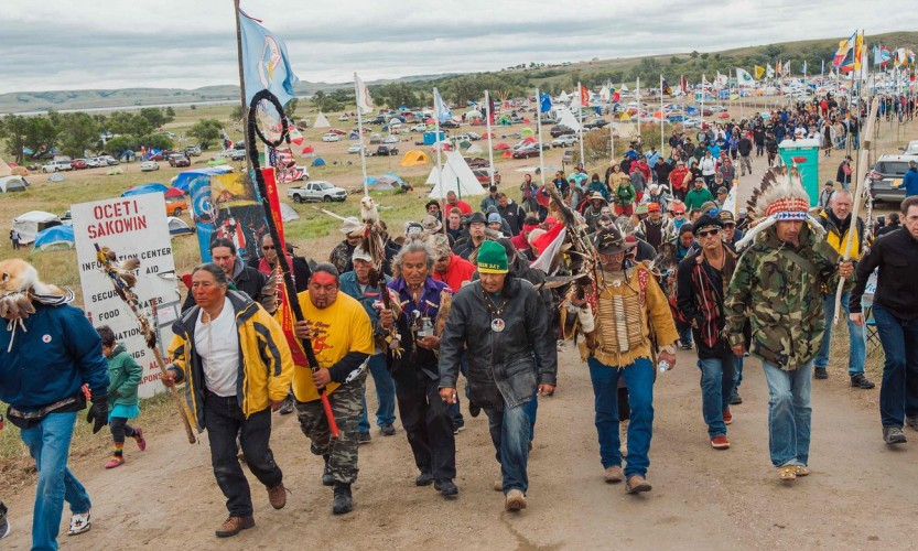 An estimated 200 First Nations and Tribes from North America have gathered in protest at Standing Rock (Photo Source: The Guardian)