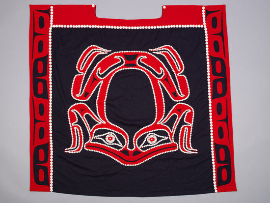 Haida hlk'yaan q'usdan (frog) k'aad gyaat'aad (button blanket) by Robert Davidson and Dorothy Grant, 1982. Photo courtesy of MOA