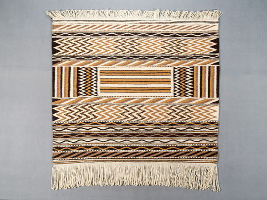 Coast Salish swuqw'alh wool blanket made by sisters Debra and Robyn Sparrow (Musqueam). Photo courtesy of MOA