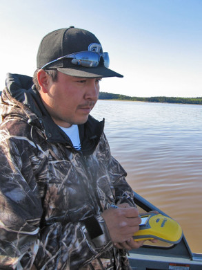 Jonathan Bruno (Athabasca Chipewyan Community Based Monitoring) sampling water at Firebag River.